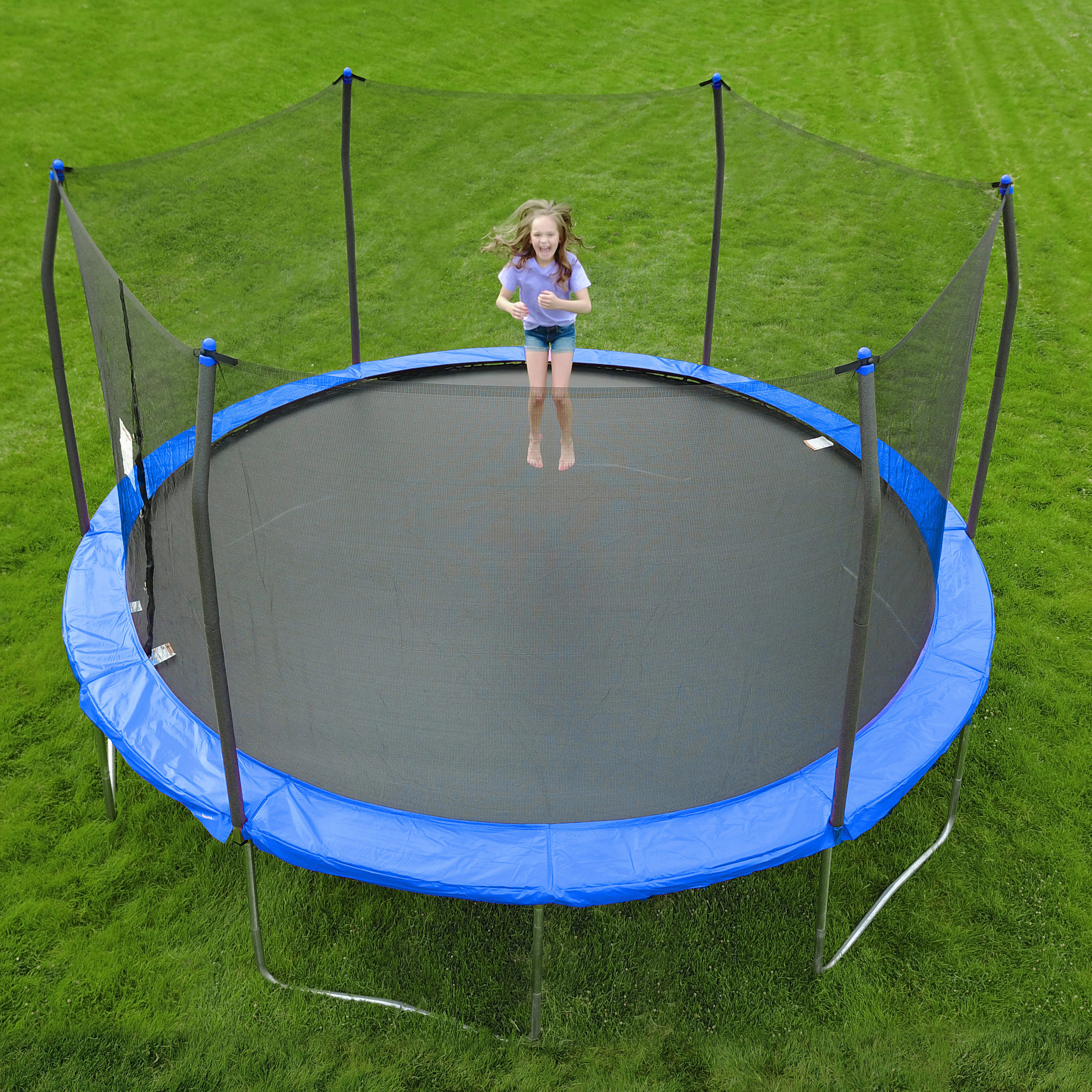 child jumping on a trampoline with a blue border and enclosure
