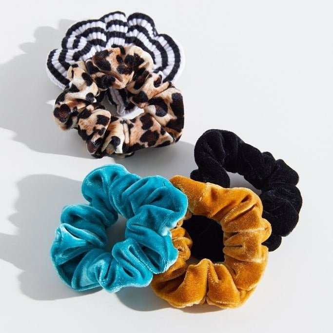 a set of velvet scrunchies