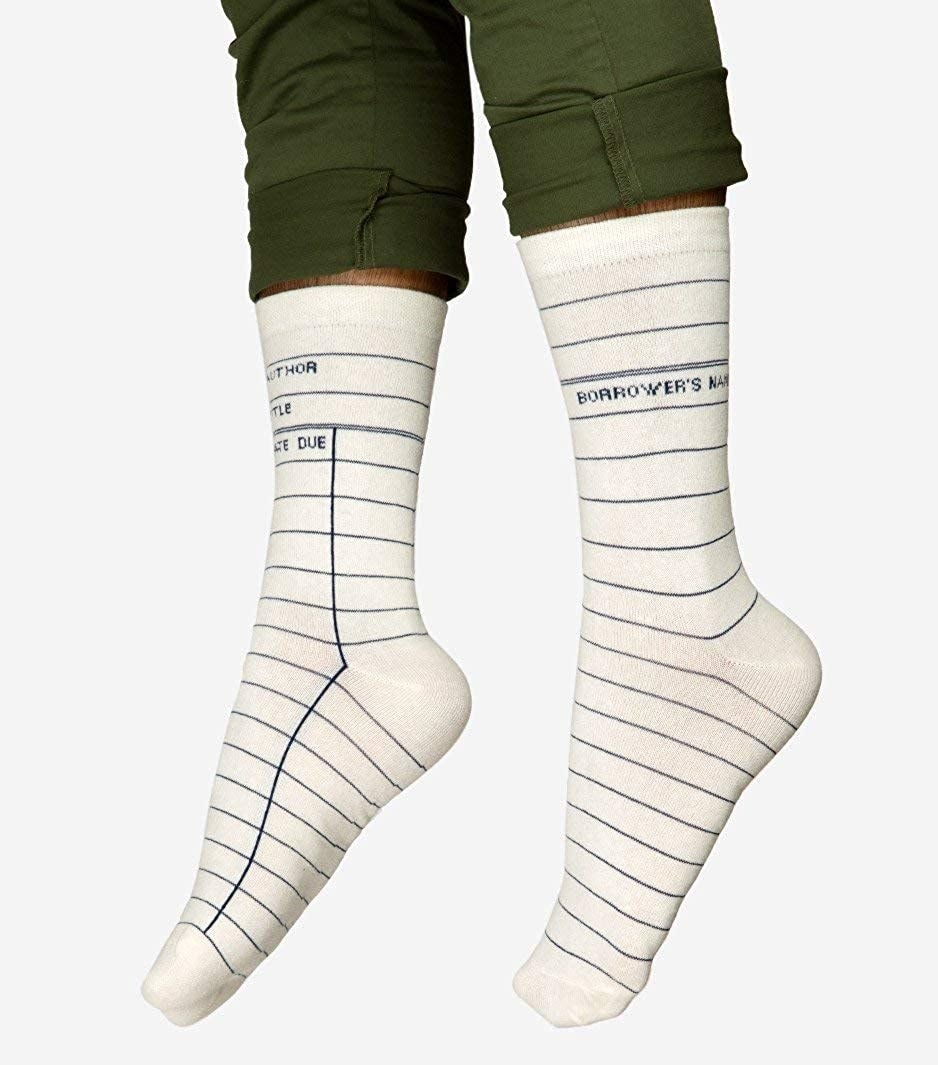 """The white socks with lines and text """"author, title, due date"""" to look like library check out cards"""
