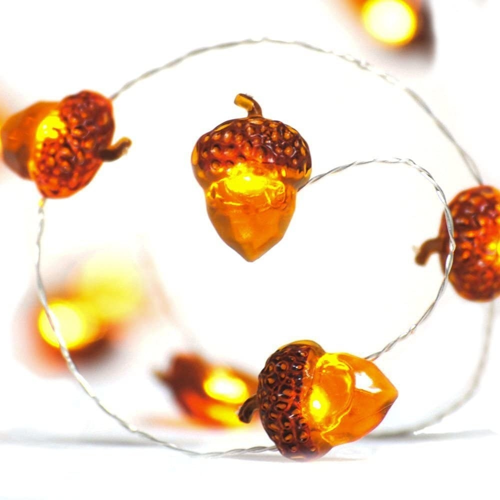 A zoomed in shot of the acorn string lights which glow yellow and orange