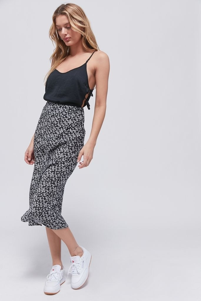 a black and white floral patterned slip skirt