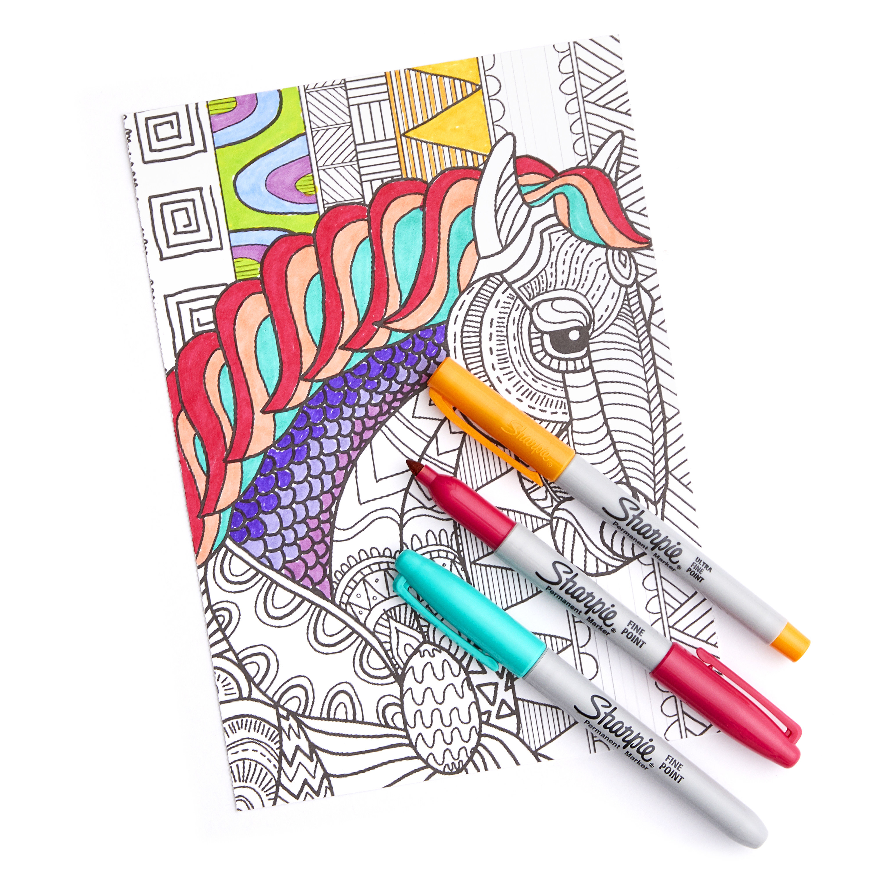 blue pink and orange sharpie markers sitting on top of a coloring sheet