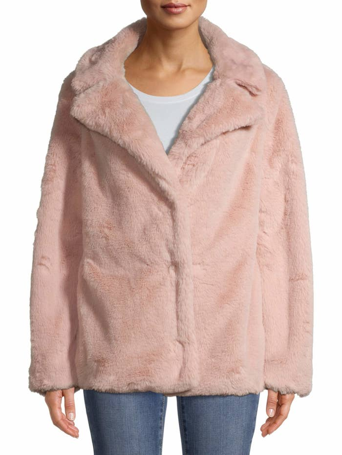 person wearing a pink faux fur jacket