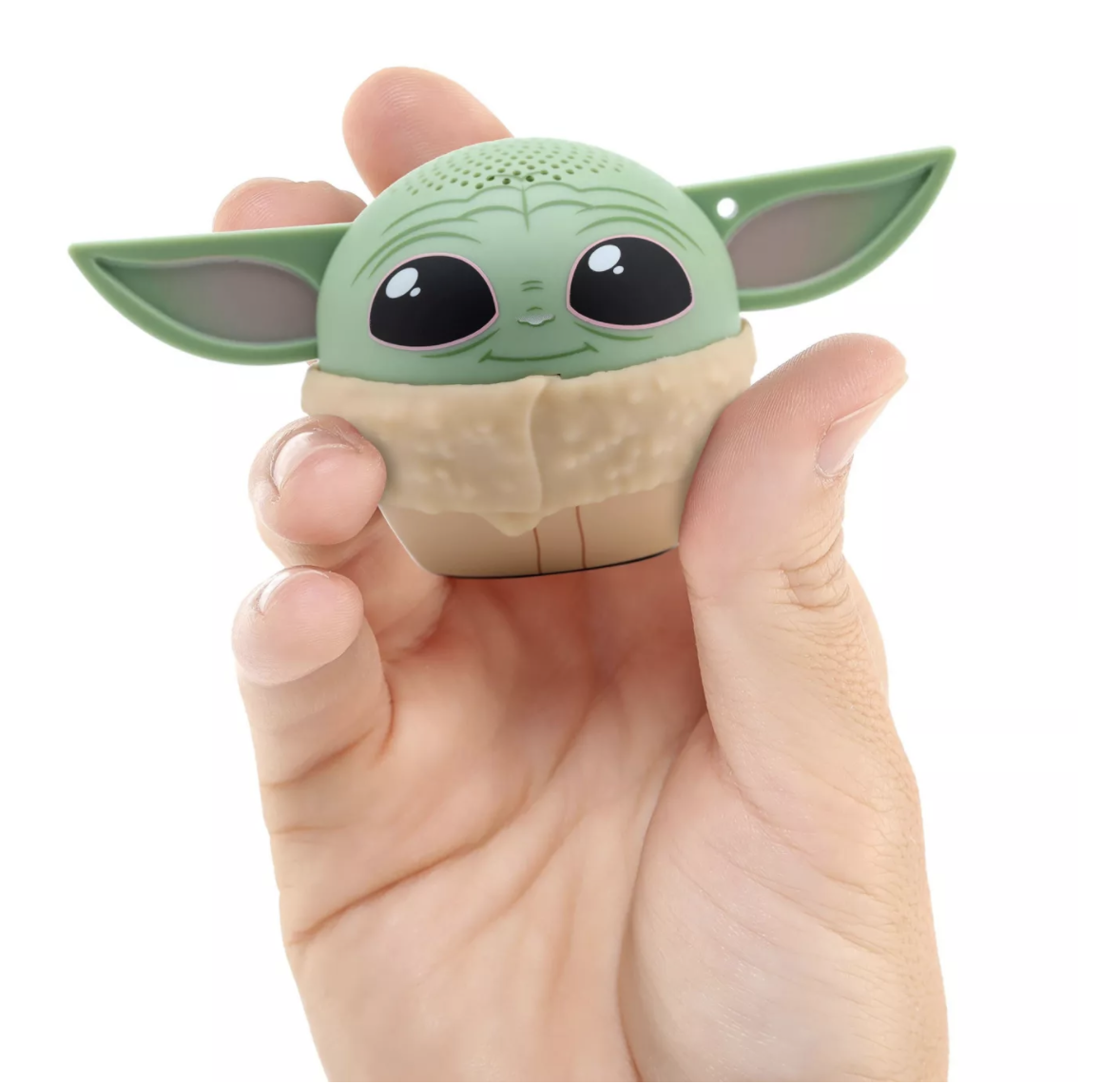 A hand holding the baby Yoda speaker which is slightly smaller than a tennis ball