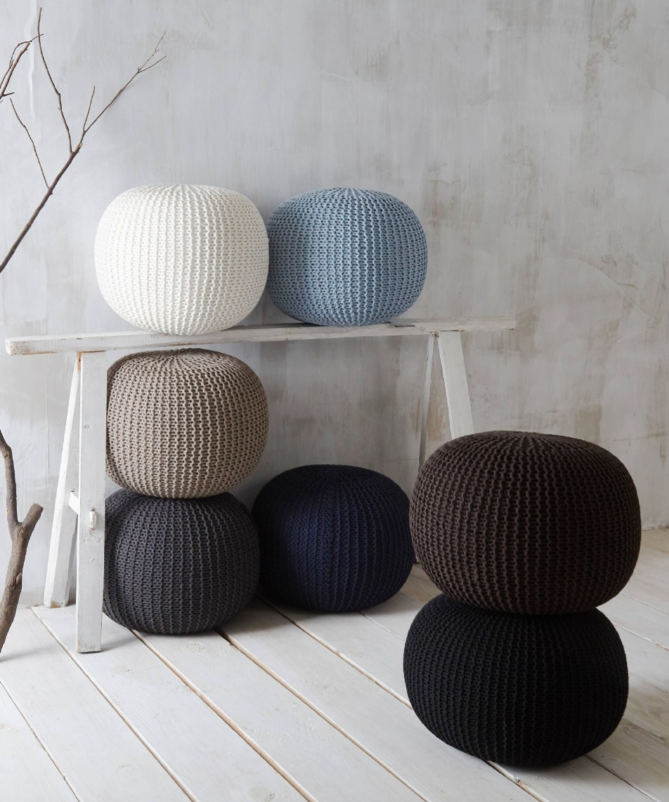 The knitted round poufs in different colors