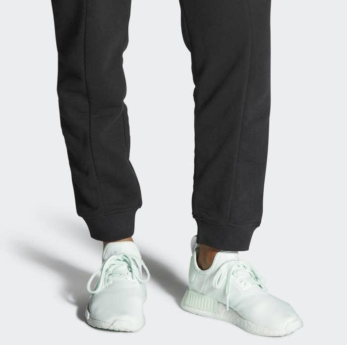 model wearing mint green sneakers