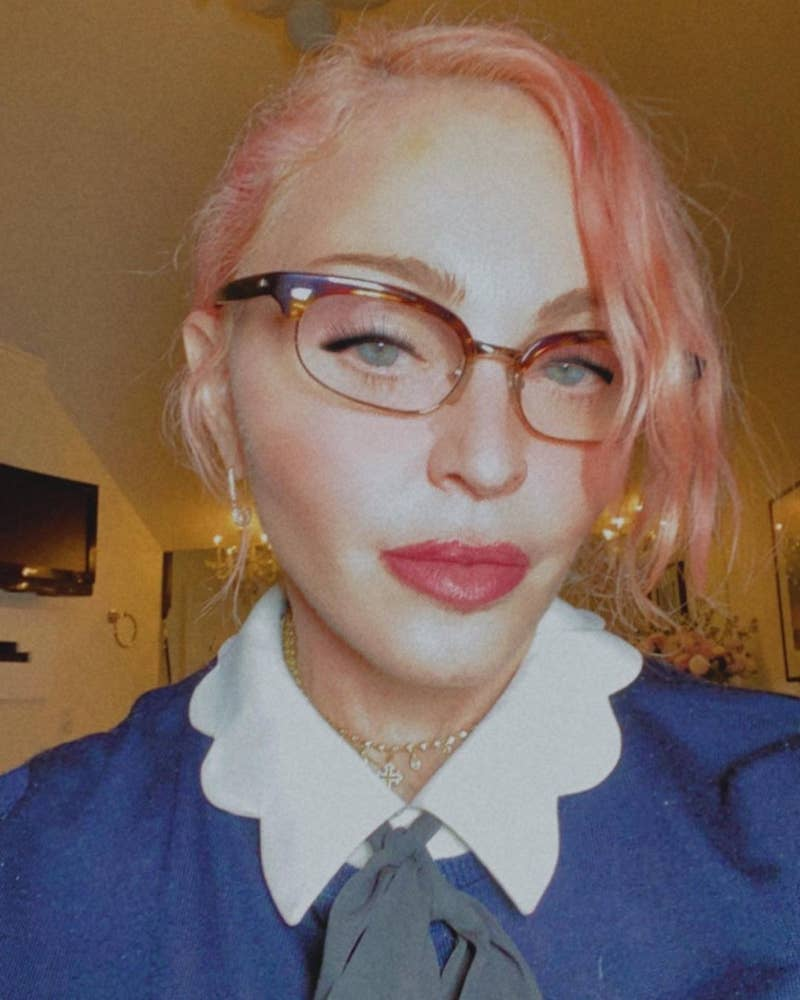 Madonna taking a selfie in quarantine while wearing glasses and pink hair