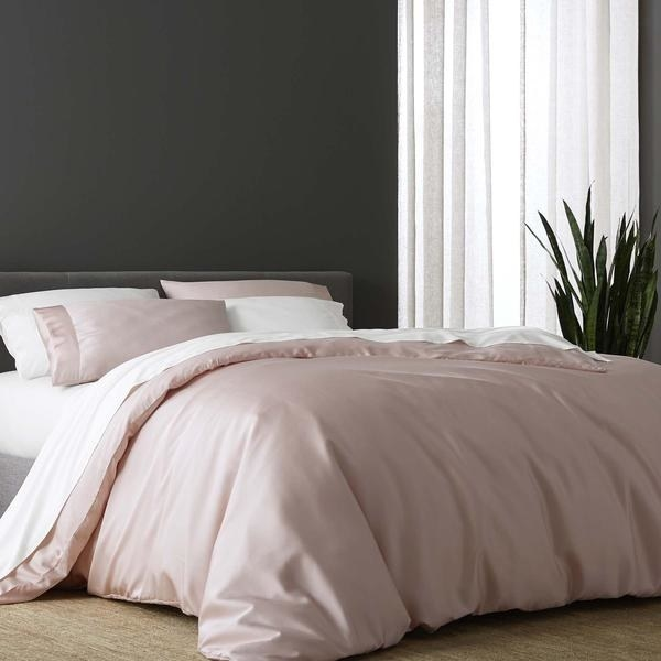 mad up bed with white sheets, pink duvet cover
