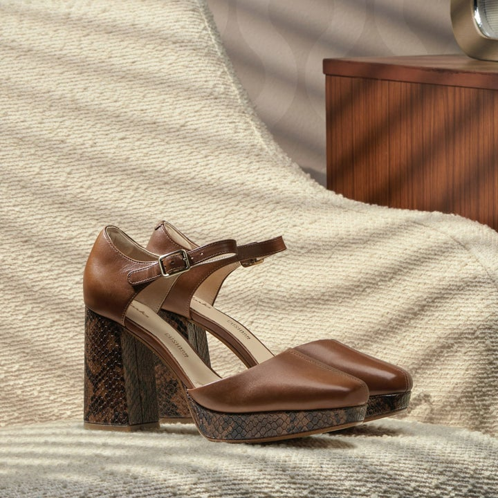 brown and snake platform heels
