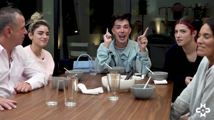 Marc, Dixie, James Charles, Charli, and Heidi at the dinner table