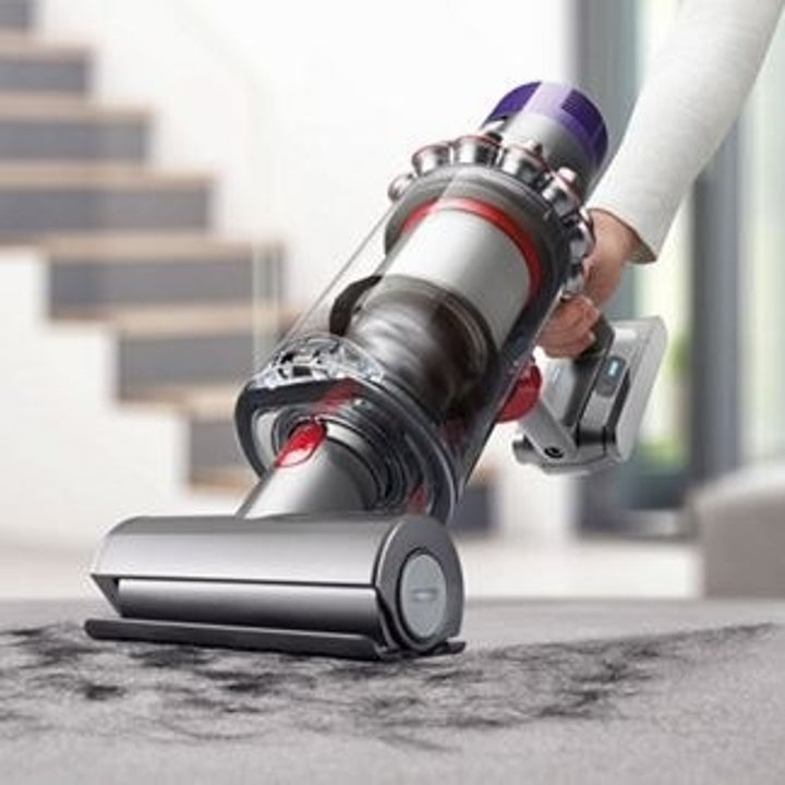 A hand using the vacuum converted to a hand vacuum