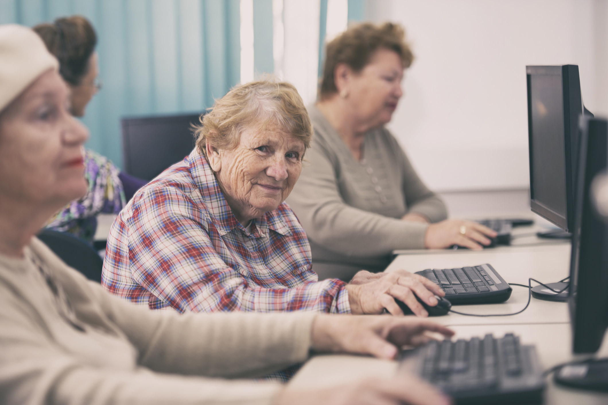 old lady at a computer smiling