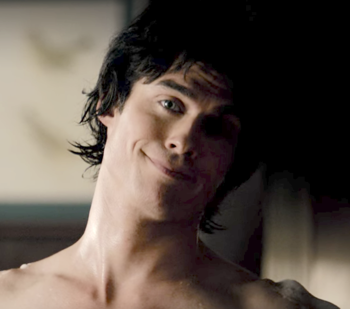 Damon with bangs and a longer back that curls up