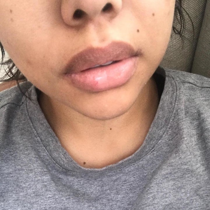 Reviewer showing how soft her lips are after using scrub