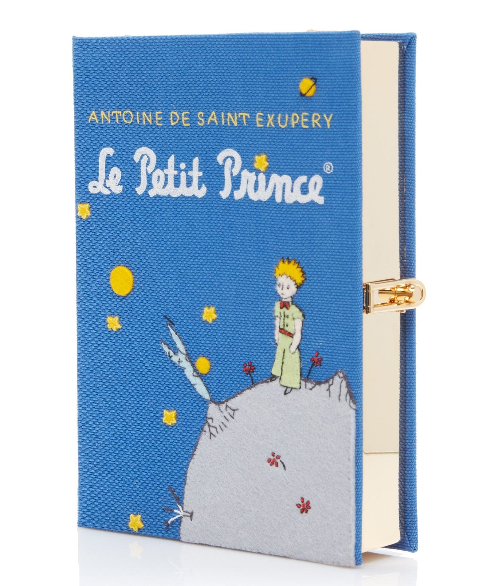 The clutch that looks like the cover of Le Petit Prince