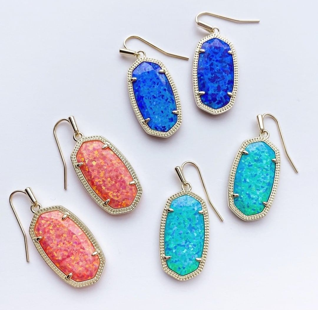 the drop earrings in pink, dark blue, and light blue