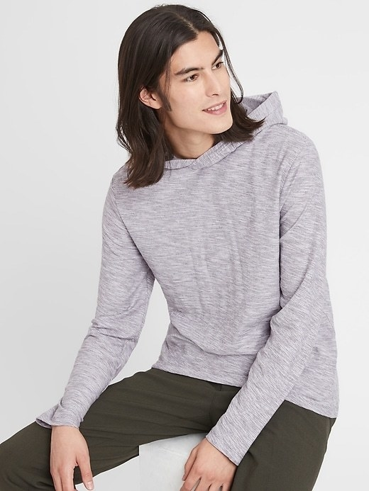 A model wearing a vintage hoodie in white and grey striped