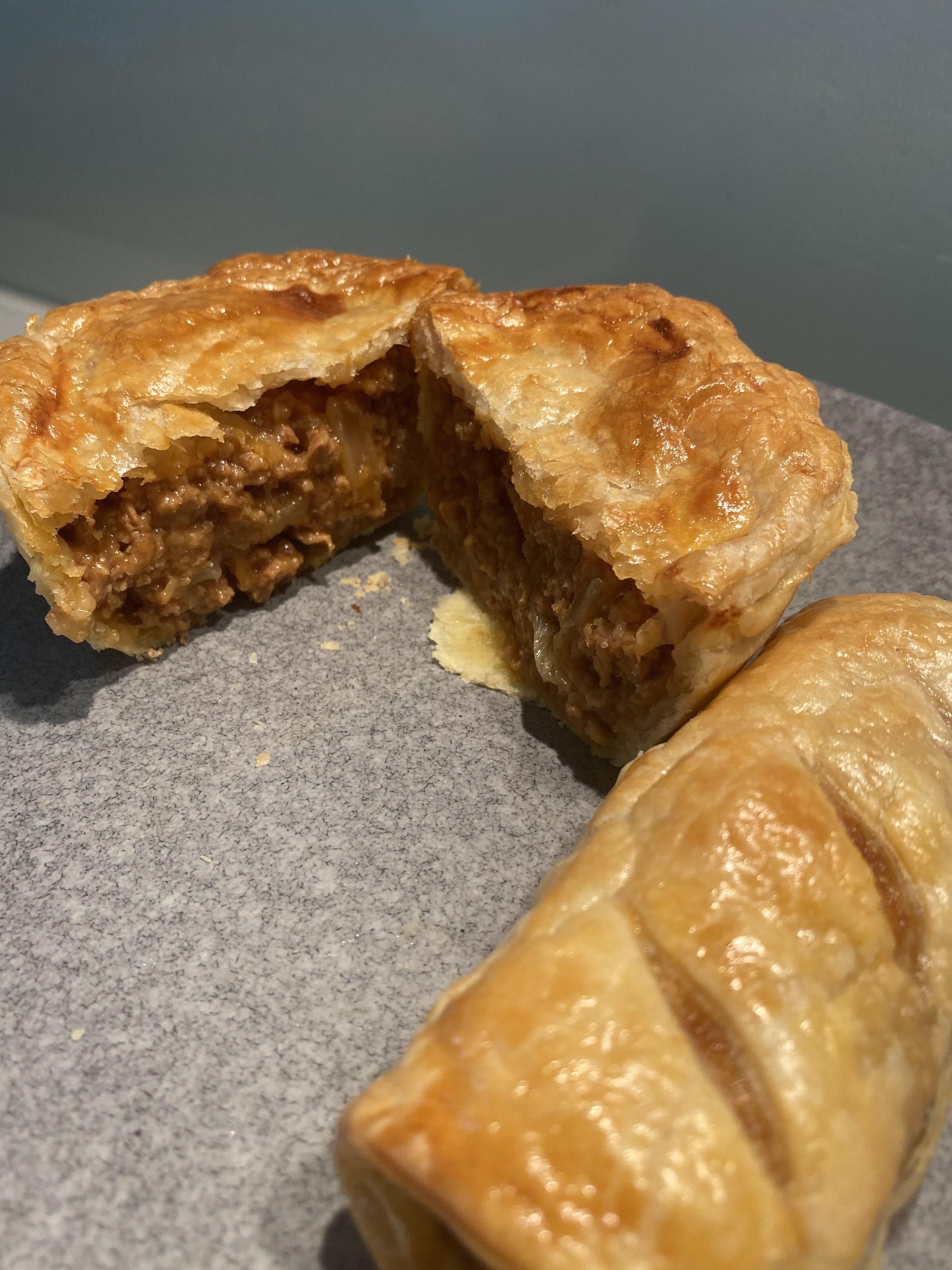 Pie cut open showing the plant-based meat inside