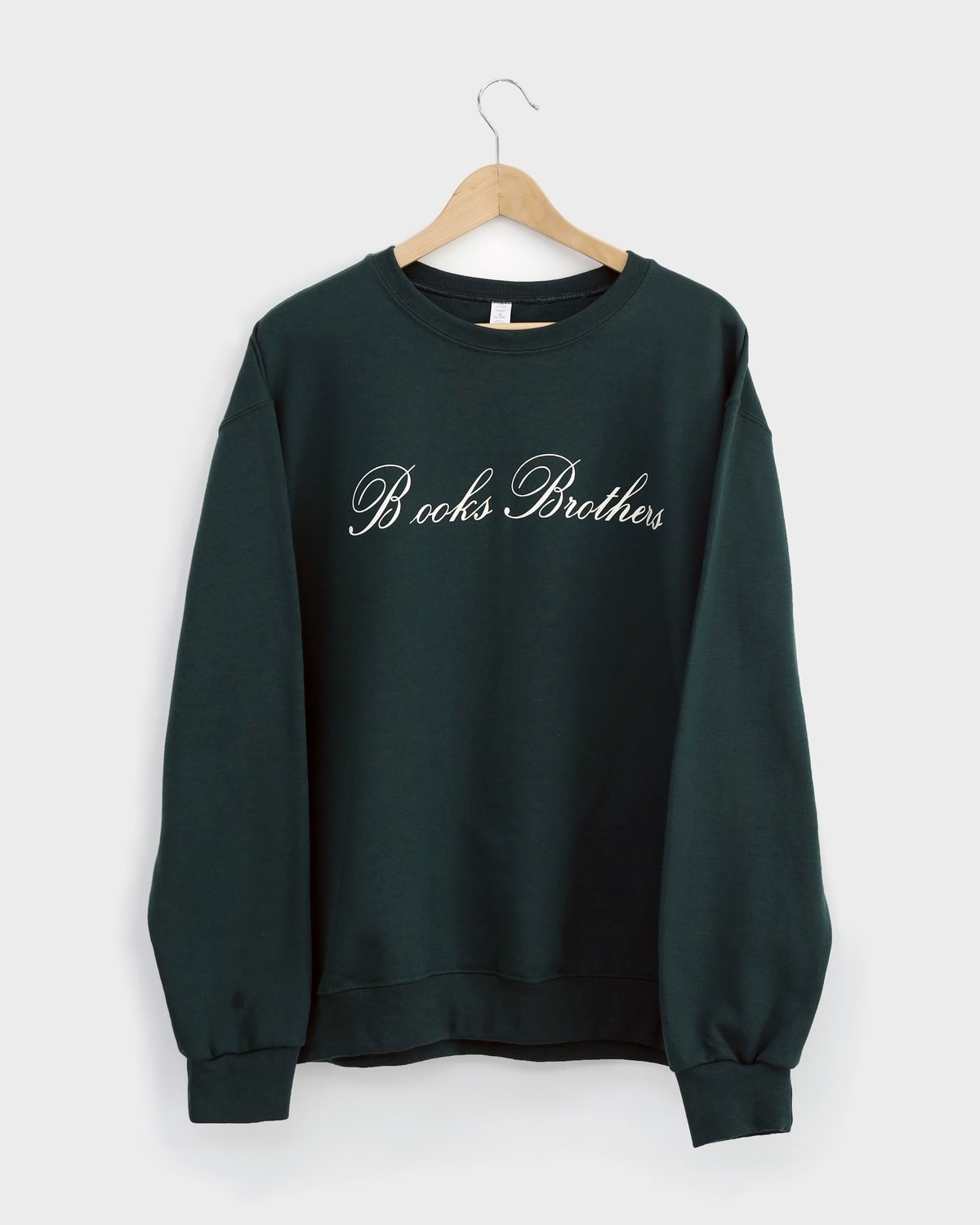 A green sweatshirt that says Books Brothers in the Brooks Brothers cursive font