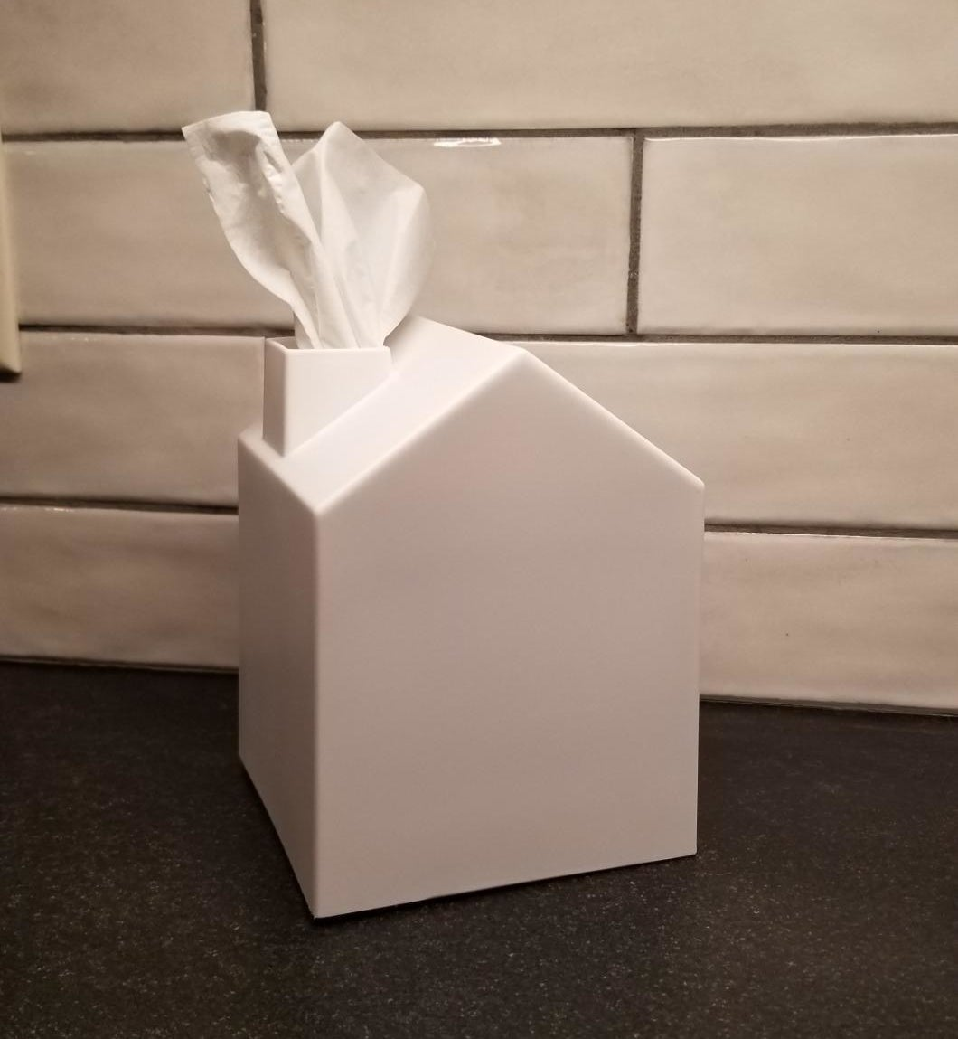 Reviewer image showing the white tissue box with a tissue coming out of the chimney