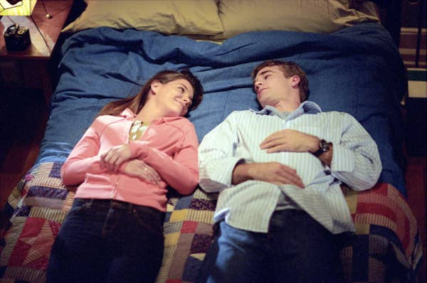 Dawson and Joey lying on his bed together