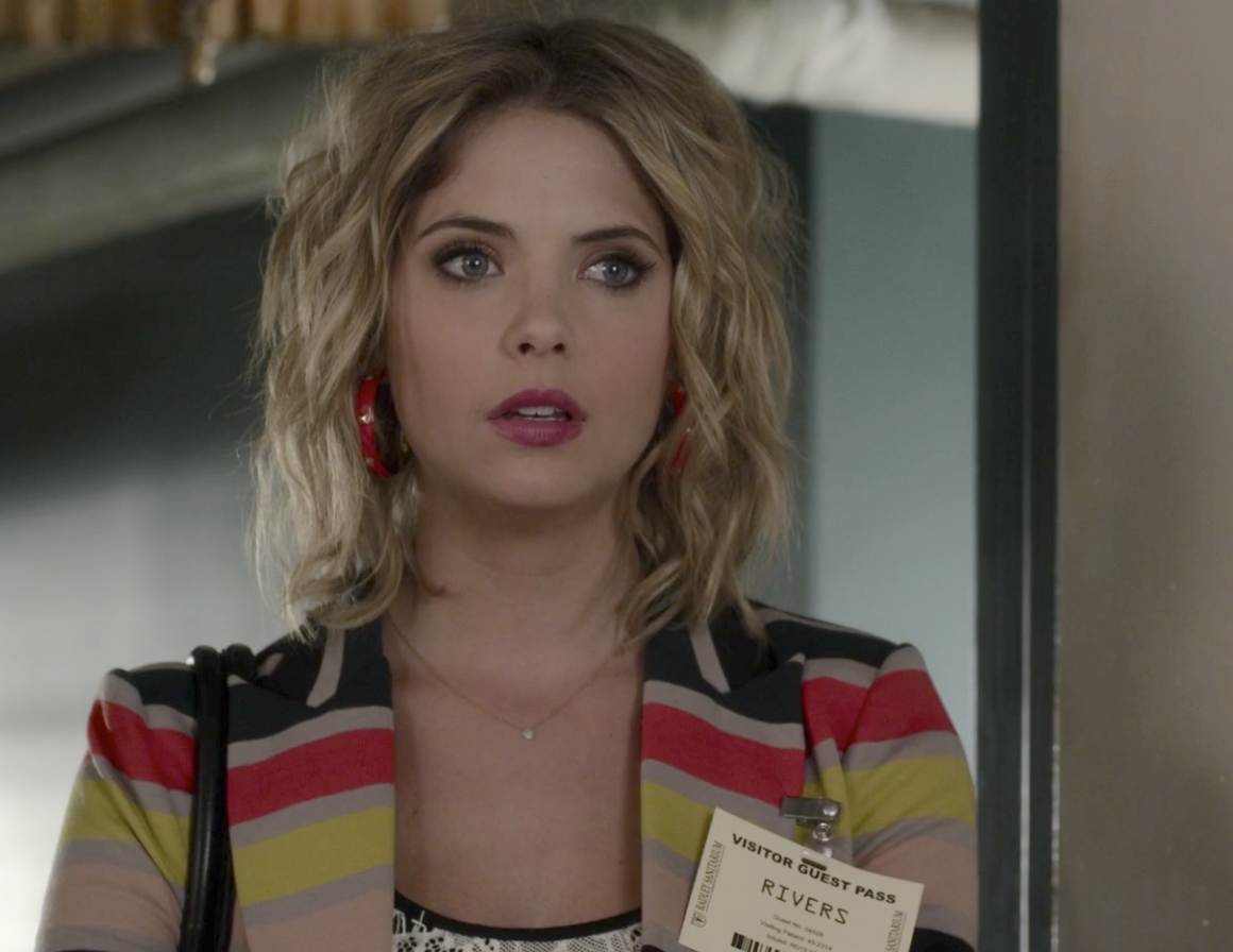 Hanna with short layered curly blonde hair