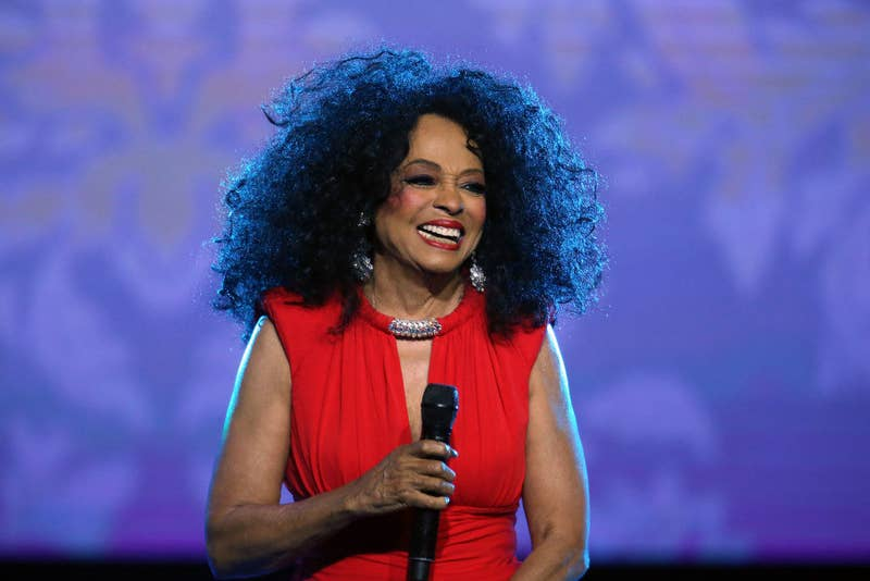Diana Ross performing at an event in 2019 or 2020, holding a microphone and smiling