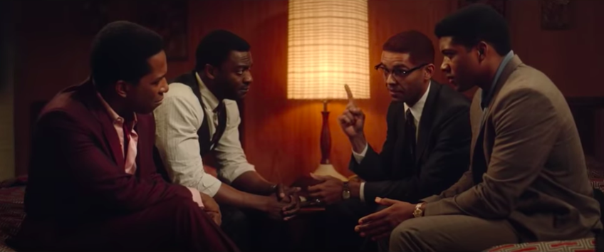 """A screenshot of Aldis Hodge, Leslie Odom Jr., Eli Goree, and Kingsley Ben-Adir in character for """"One Night In Miami"""""""