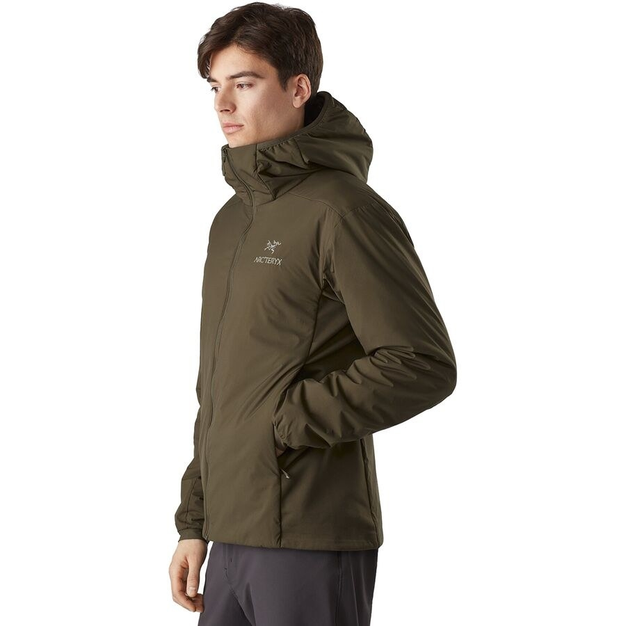 model in an olive Arcteryx hooded jacket