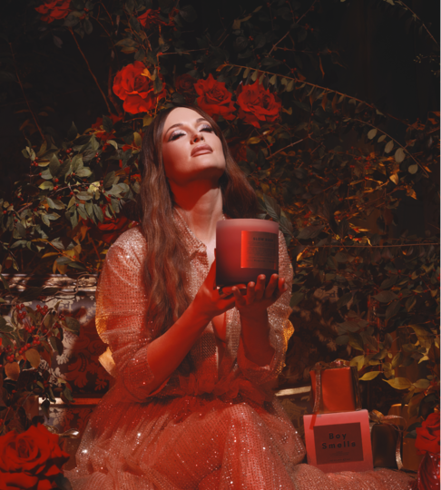 Kacey Musgraves holding a large candle