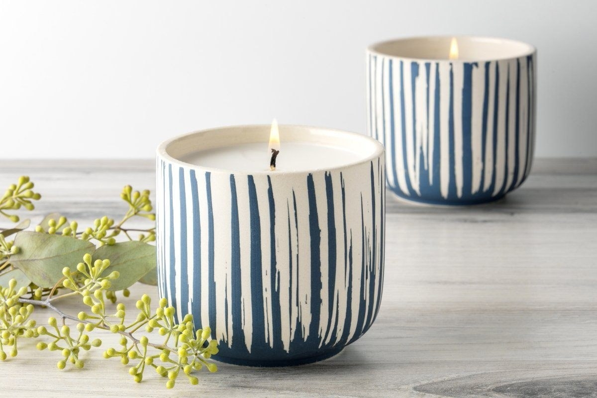 jar candle that's white ceramic with blue striations