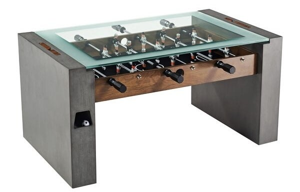 gray and wood foosball table with glass tabletop