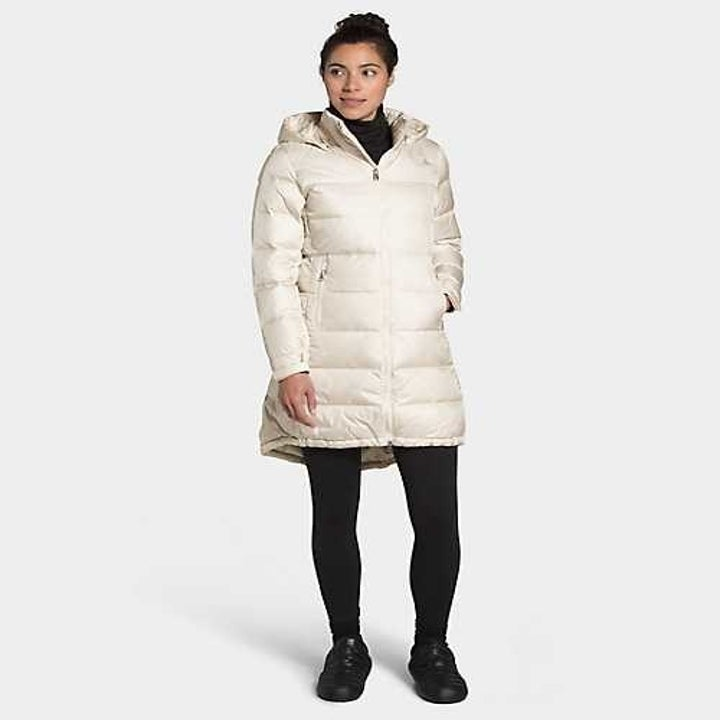 Model wearing the mid-thigh length puffer jacket in white