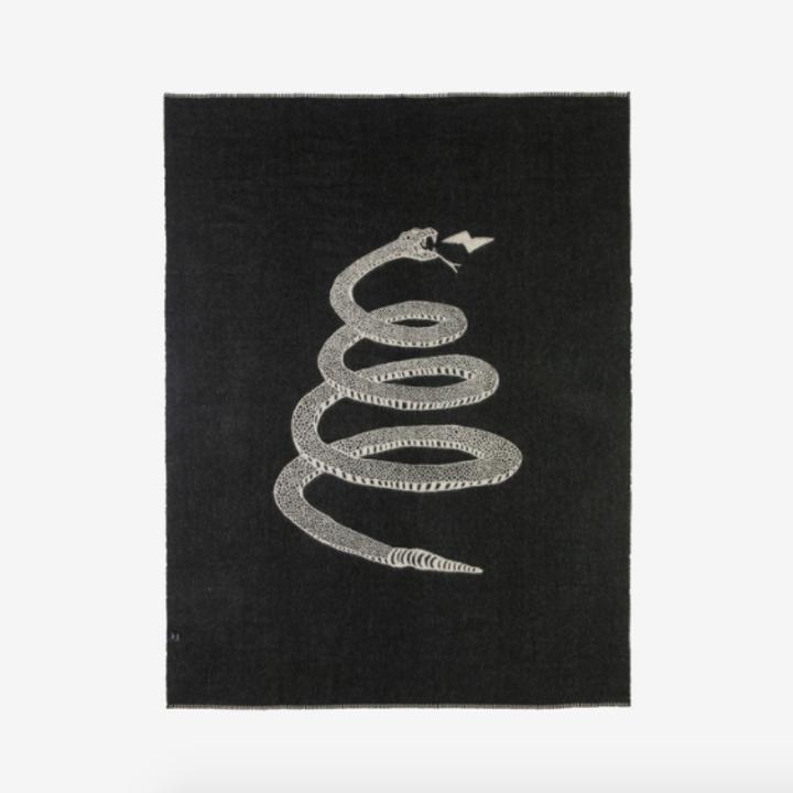 black blanket with large gray snake pattern