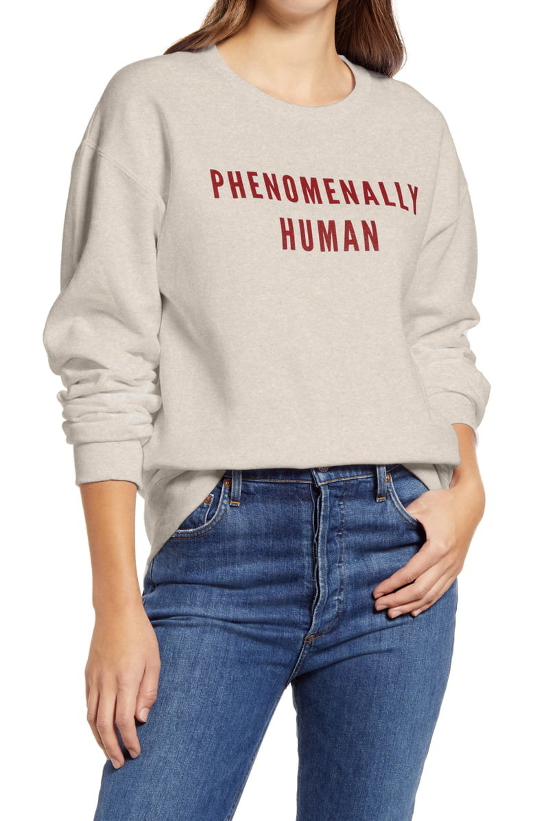 "Crewneck sweatshirt in beige with the words ""Phenomenally Human"" written in red across the center"