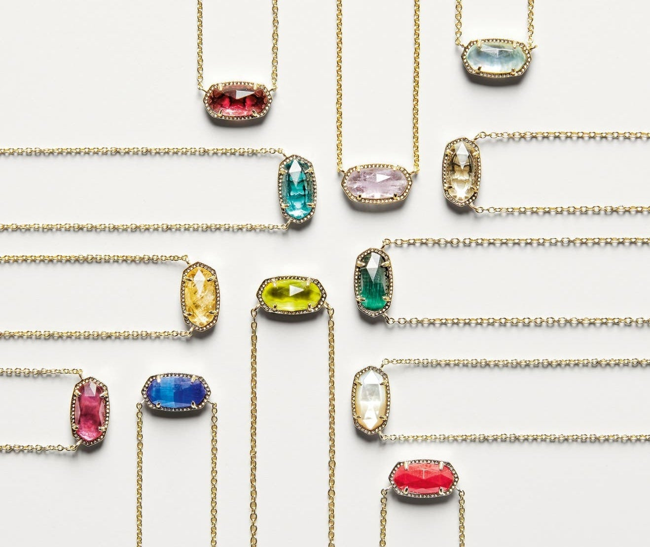 Twelves oval-shaped pendents in different-colored stones on cold chains