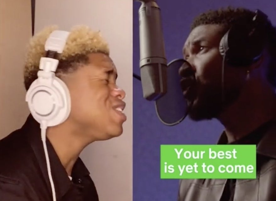 A young man with blonde hair sings