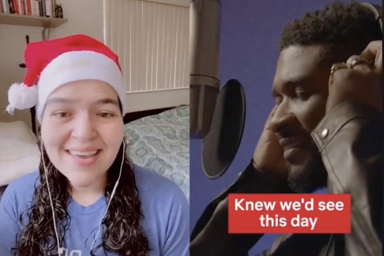 A woman in a Santa hat sings