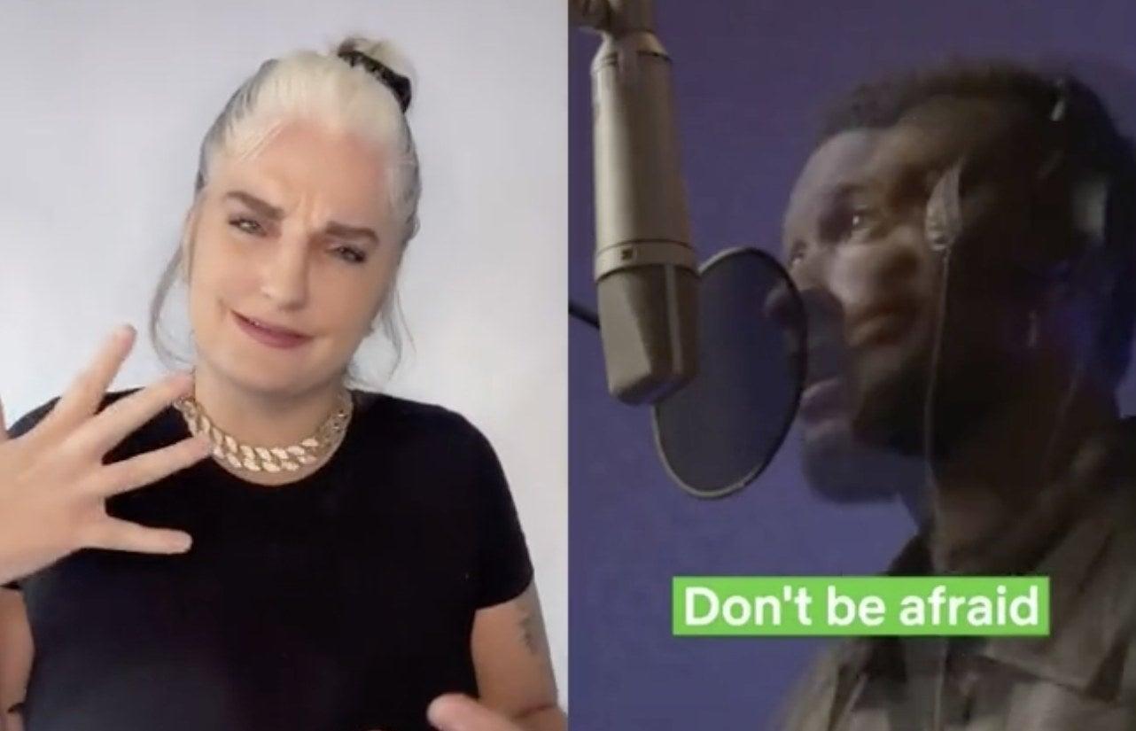A woman uses sing language to sing