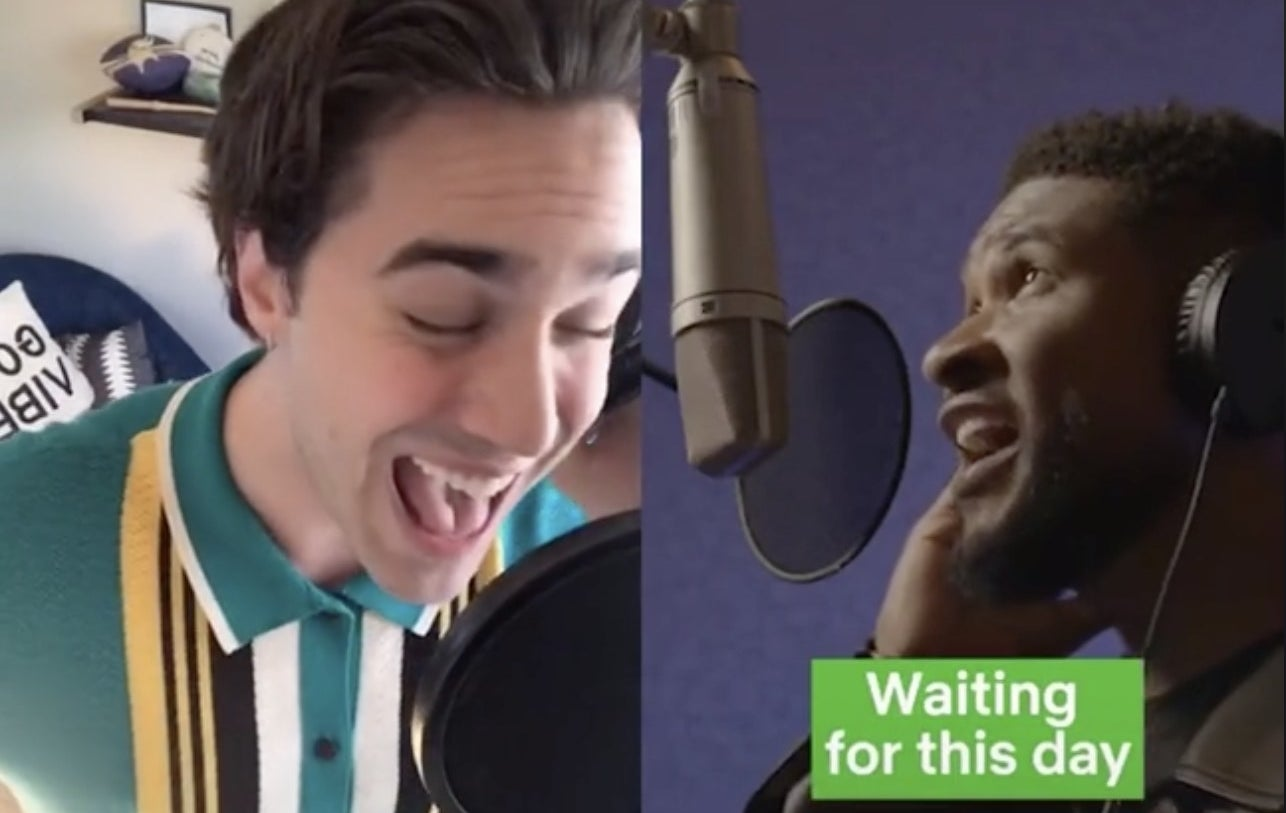 A man sings with his mouth wide open