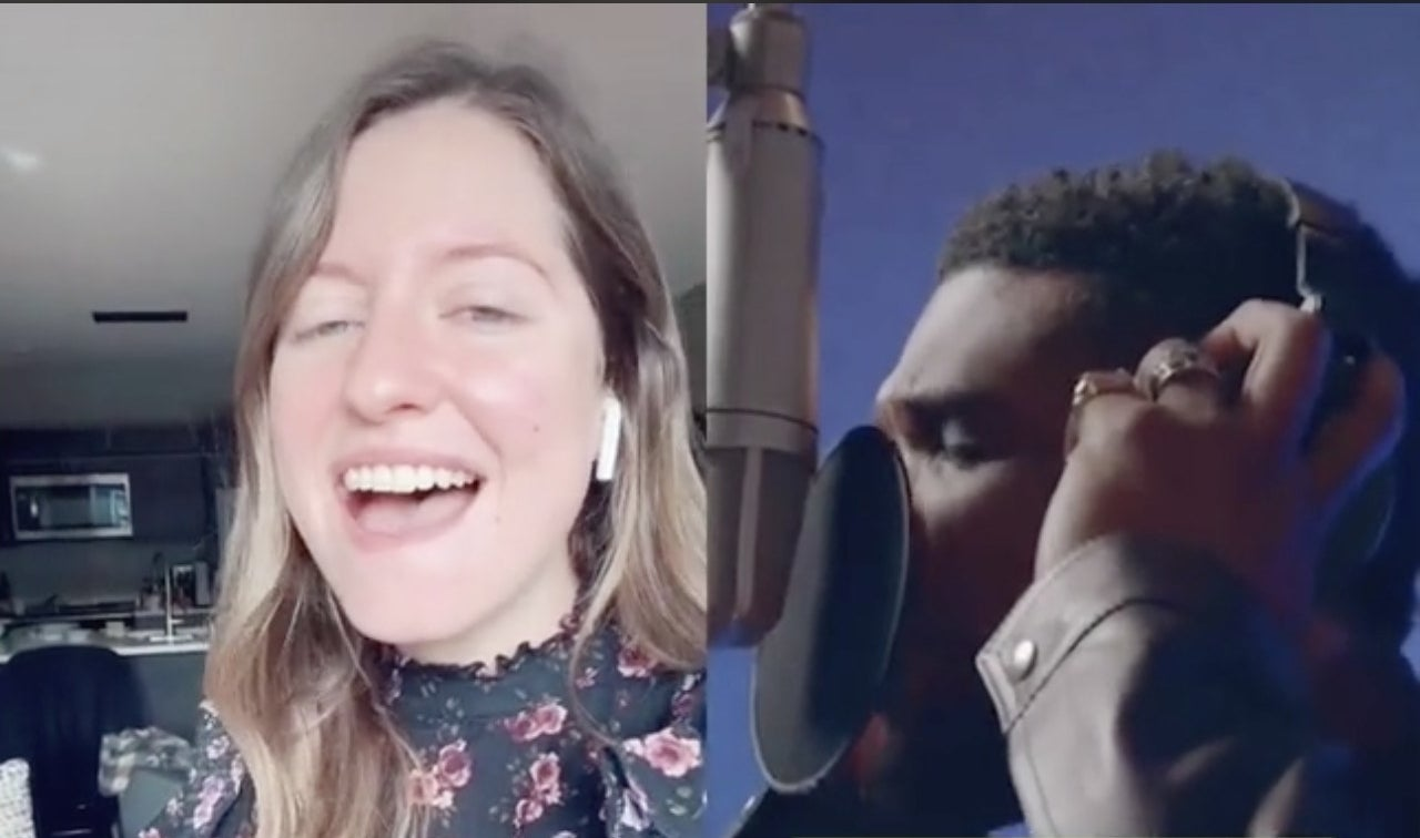 A woman sings into her airpods