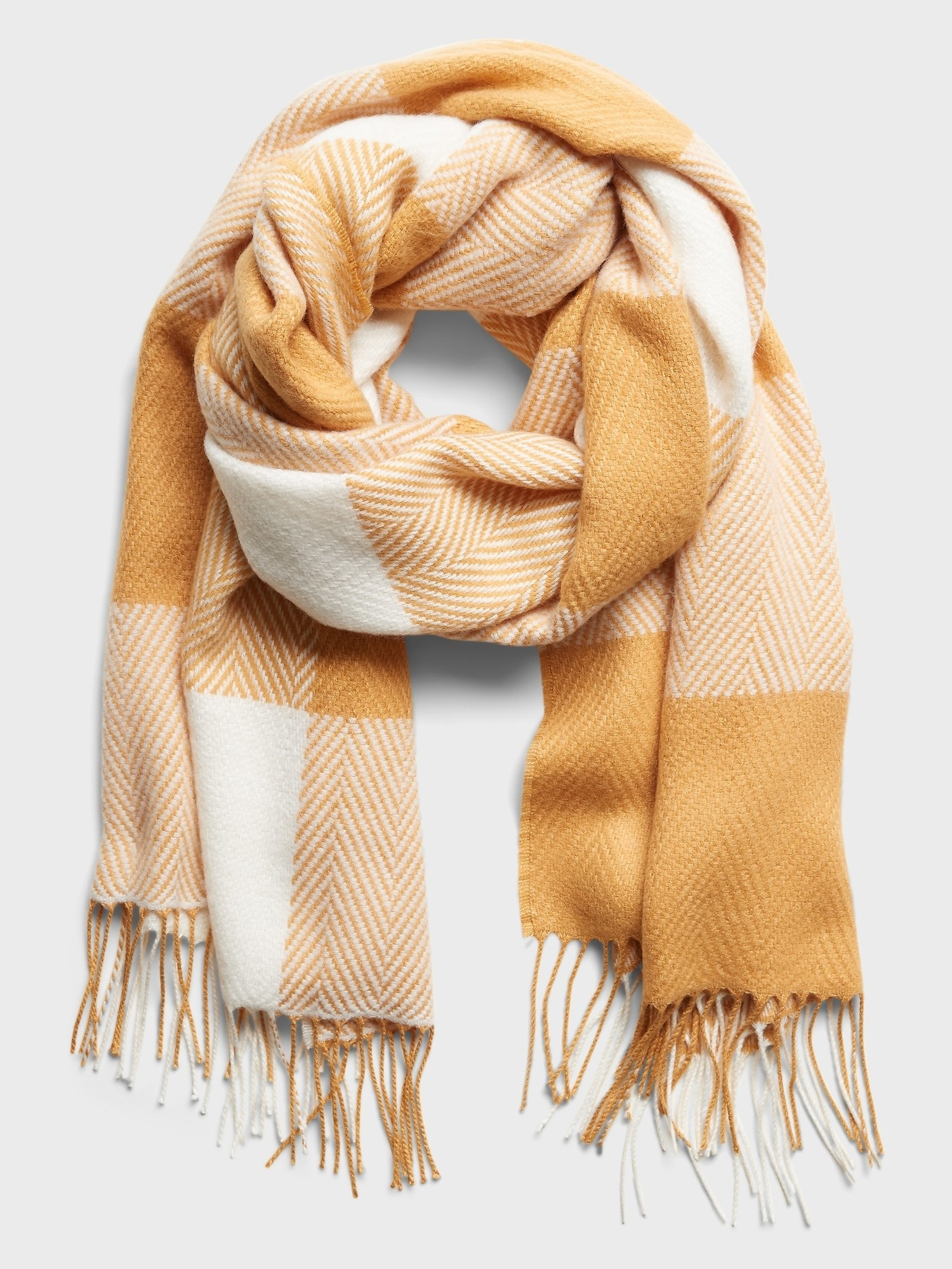 A plaid scarf in  yellow plaid that they call gold plate