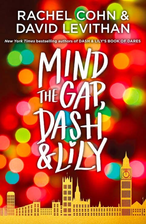 """""""Mind the Gap, Dash & Lily"""" by Rachel Cohn & David Levithan book cover; featuring Christmas lights in the background and a London skyline silhouette"""
