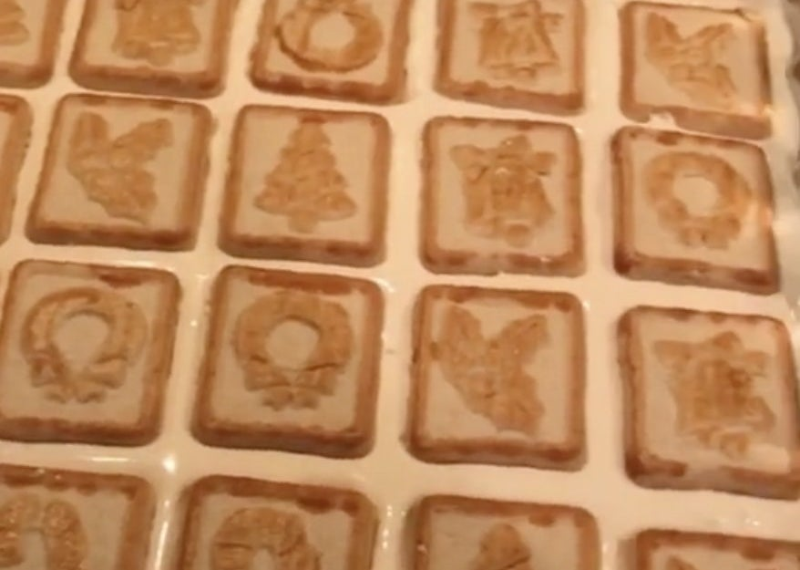 A cake covered in chessmen cookies