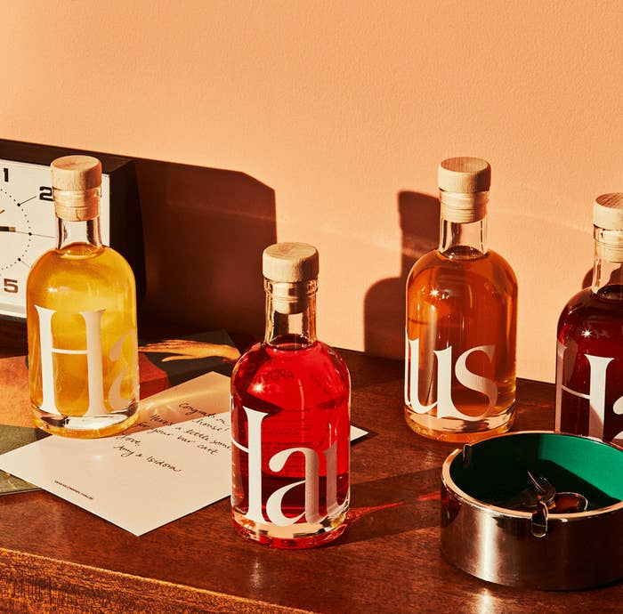 Four bottles of Haus styled on a table