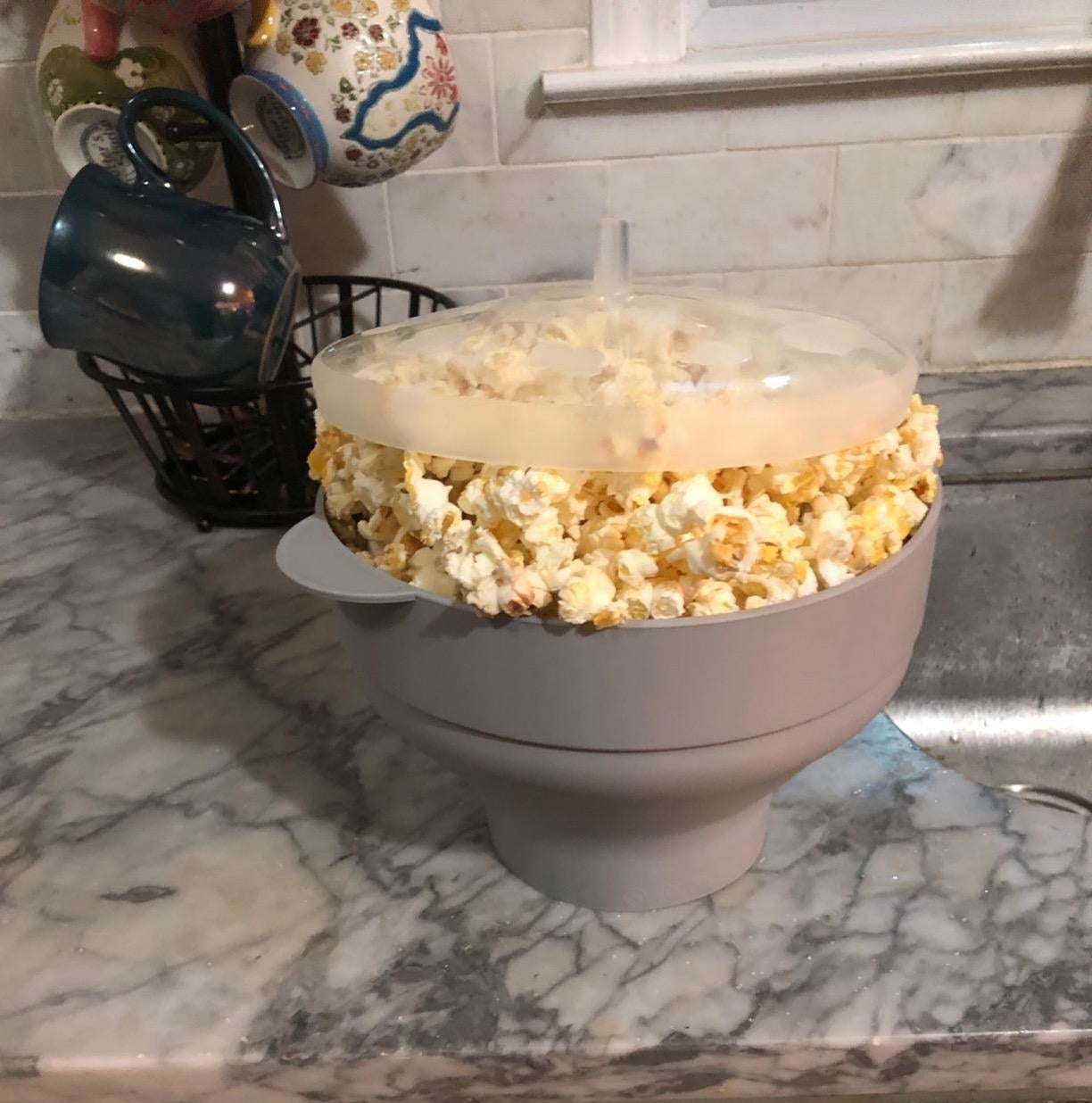 A reviewer's grey popper with popcorn inside