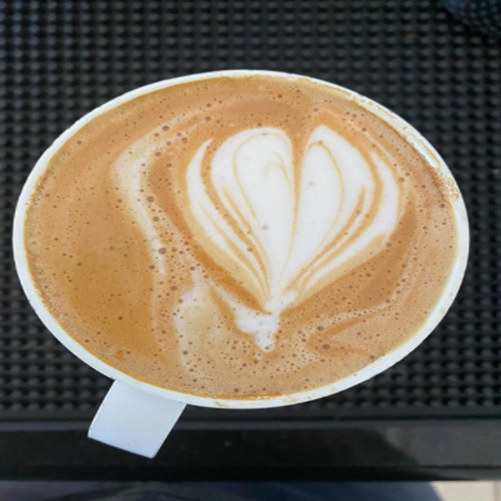Reviewer photo showing heart latte art in their Ember mug