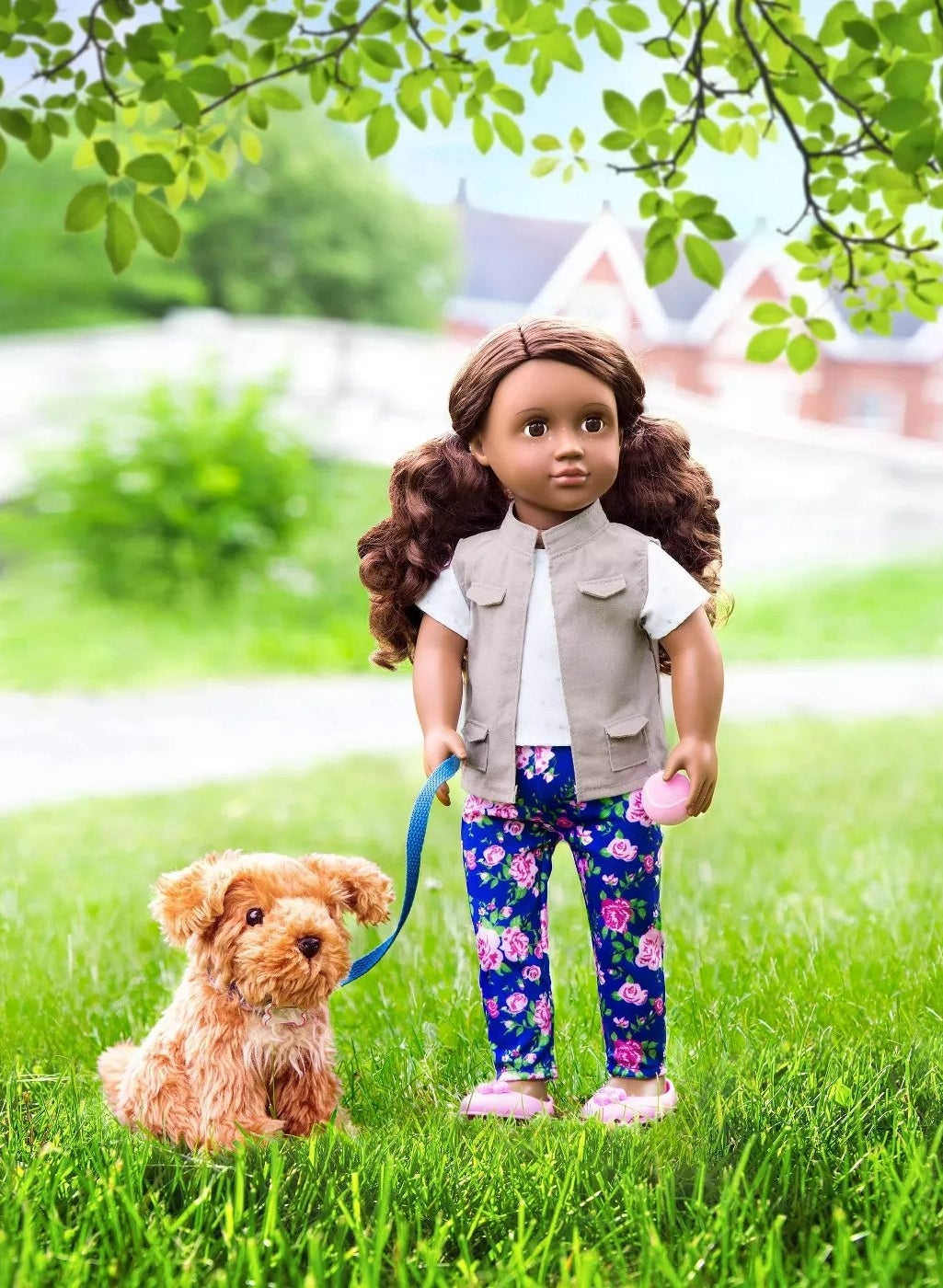 The doll with a tennis ball and her dog on a leash