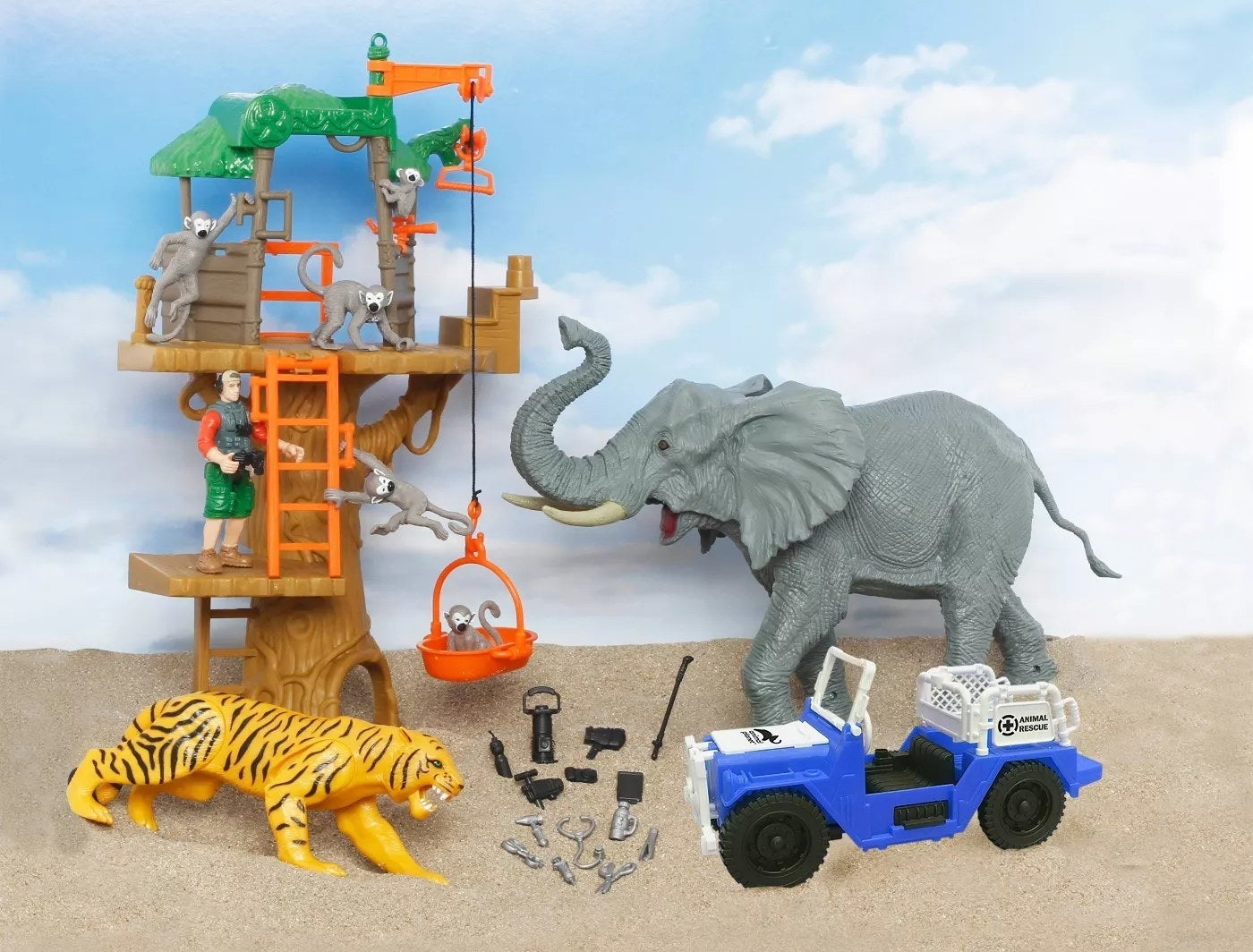A toy treehouse with five monkeys, an explorer, a tiger, an elephant, a rescue Jeep, and 15 rescue accessories