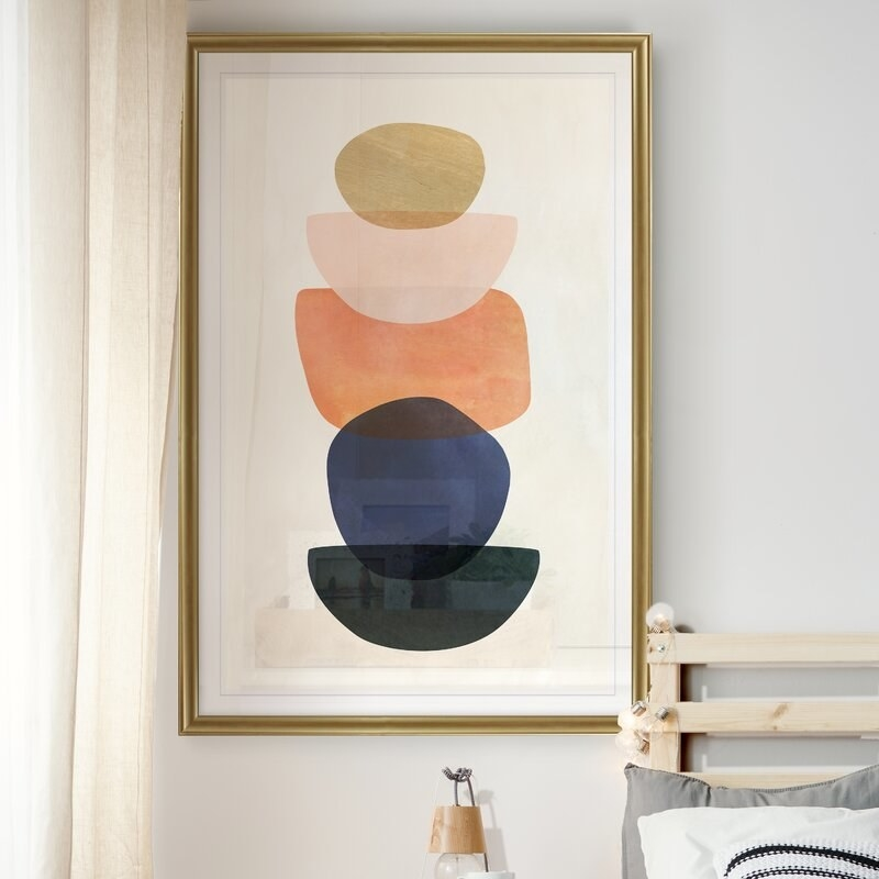 Graphic art print hung on the wall